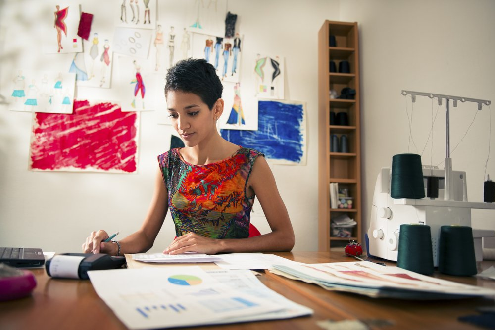 Business owner preparing a business plan to grow business and apply for funding